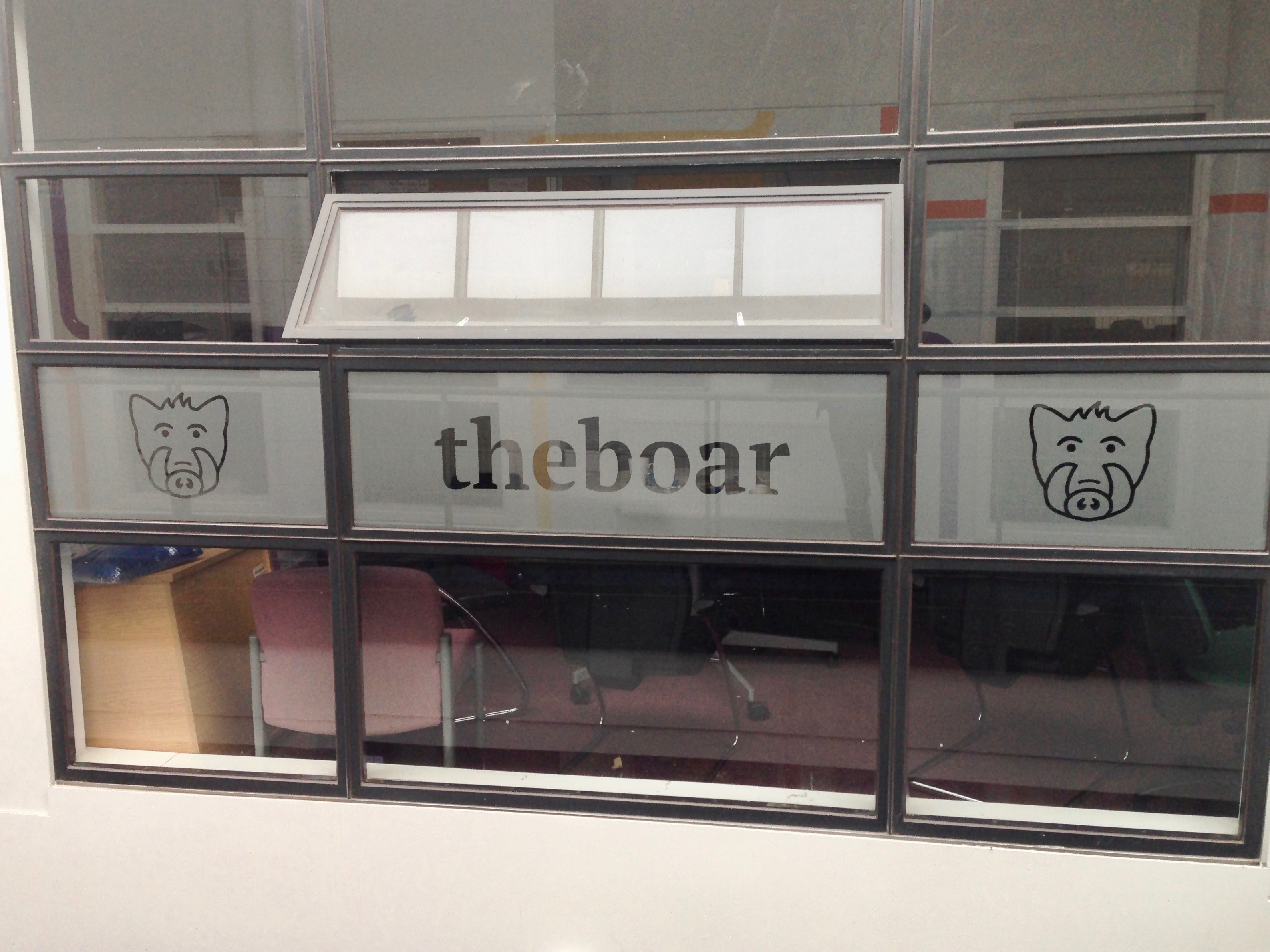 The Boar's logo printed on a window.